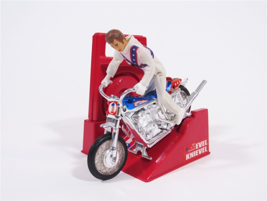 1970S EVEL KNIEVEL DAREDEVIL MOTORCYCLE WITH WIND-UP LAUNCHER