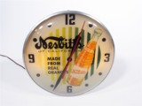 1958 NESBITTS OF CALIFORNIA LIGHT-UP CLOCK