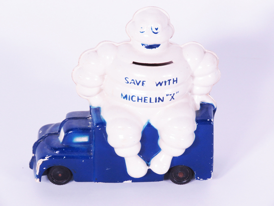 1950S MICHELIN TIRES COIN BANK WITH BIBENDUM FIGURE