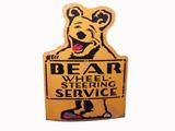 CIRCA LATE 1950S BEAR WHEEL-STEERING SERVICE TIN SIGN