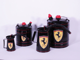LOT OF FOUR 1940S-50S MULTI-FLUID TINS IN FERRARI REGALIA