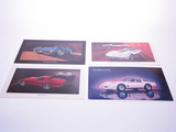 LOT OF FOUR CHEVROLET CORVETTE DEALER CARDBOARD SIGNS
