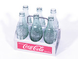 CIRCA 1950S COCA-COLA ALUMINUM SIX-PACK CARRIER WITH PERIOD COCA-COLA BOTTLES