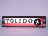 1930S-40S TOLEDO AUTOMOTIVE PARTS COUNTERTOP DISPLAY SIGN