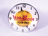 EARLY 1950S LEAK-PROOF PISTON RINGS LIGHT-UP CLOCK