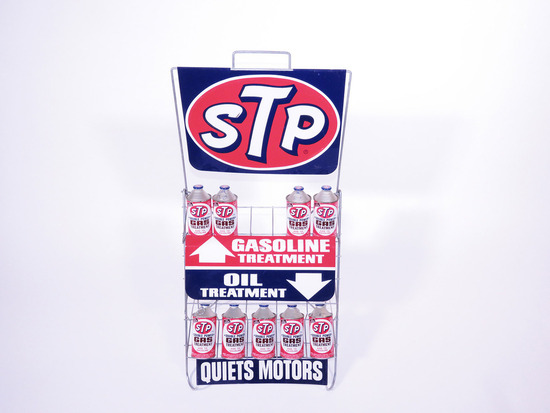 CIRCA 1960S STP ENGINE TREATMENT DISPLAY RACK FULL OF STP CANS
