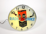 Unusual 1950s RCA Radio Service glass-faced light-up dealer clock with period Tube carton graphic.