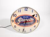 Seldom seen 1956 Grapette Soda of Texas glass-faced light-up diner clock.