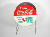 LATE 1950S-EARLY 1960S COCA-COLA METAL TIRE HOLDER