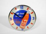 1956 ORANGE KIST SODA GLASS-FACED LIGHT-UP CLOCK