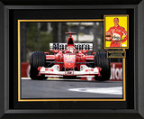 Expertly framed Michael Schumacher racing piece featuring an autographed photo.