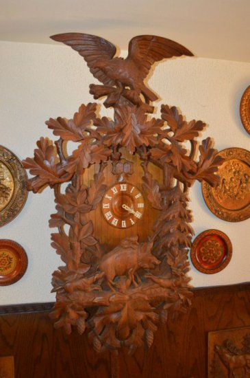 ORNATELY CARVED GERMAN CUCKOO CLOCK WITH BOAR BELOW