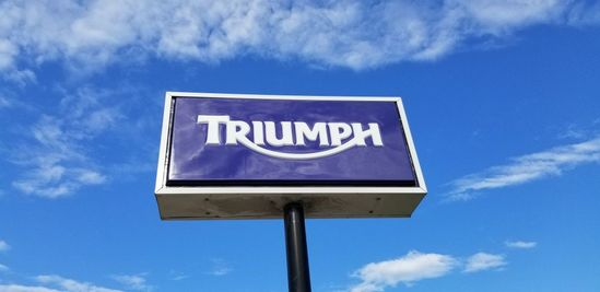 OUTDOOR TRIUMPH SIGN WITH POST