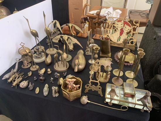 Brass figurines, candle stick holders, plus