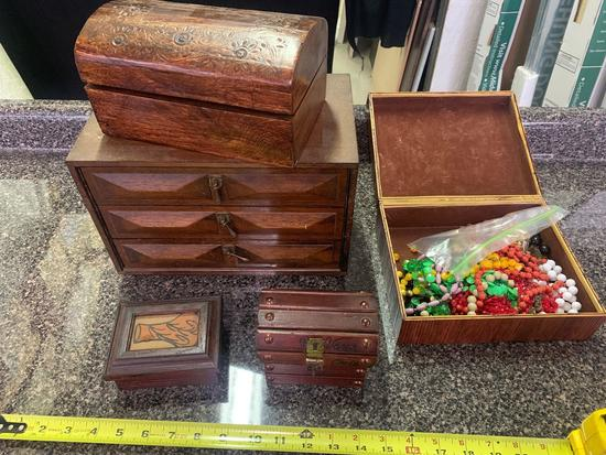 Wooden boxes one containing costume jewelry