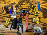 Tape measures telemaster tool, pipe cutter, square,knives plus