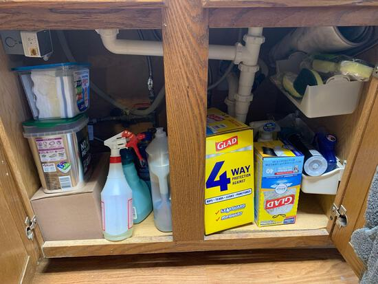 Cabinet full of trash bags dishwasher tablets cleaning supplies