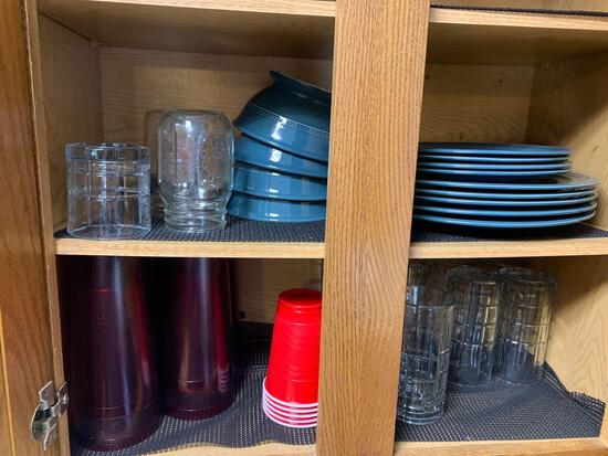 Cabinet full of glasses plates Bowls plus