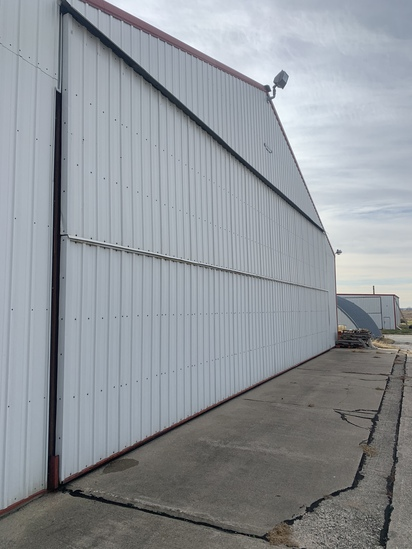 Approximate 45 foot Hanger door on building that runs East and West