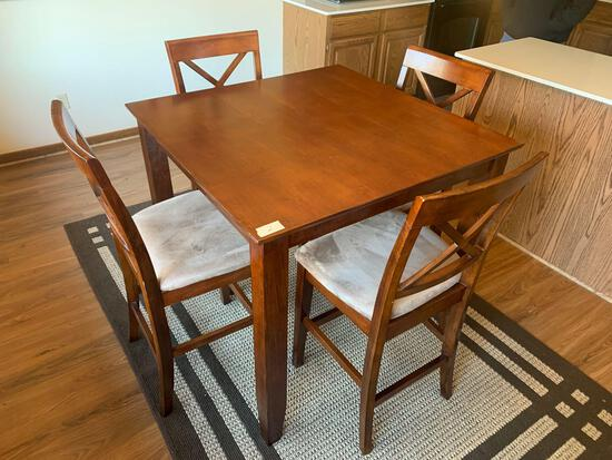 4x4 hard wood bar top table and 4 chairs