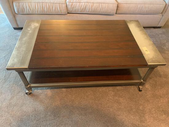 Nice coffee table on rollers metal edge 4x2