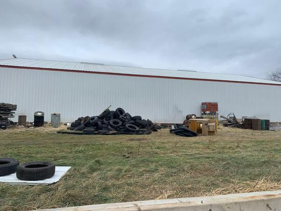 Tires pallets 50 gallon drums tank holders all items on the side of the building