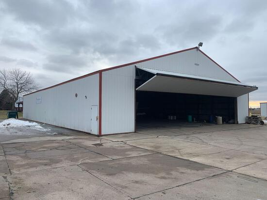 Lester 70x105 pole building. (Hanger doors not included) plus all contents inside of building