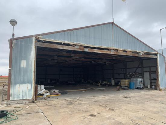 Lester Hanger 55x70 no hanger door building that is north and west on property and all contents