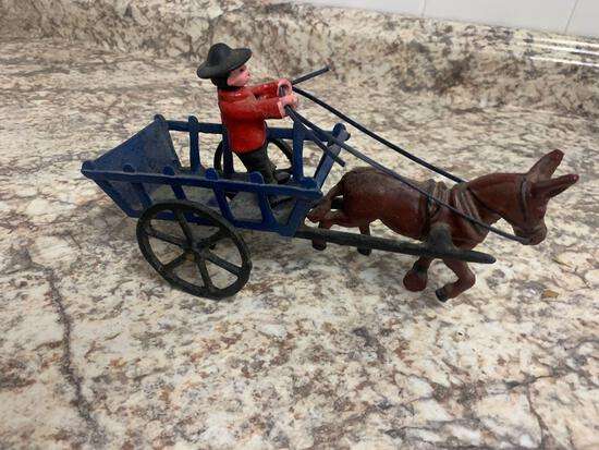 Cast iron horse and buggy with man