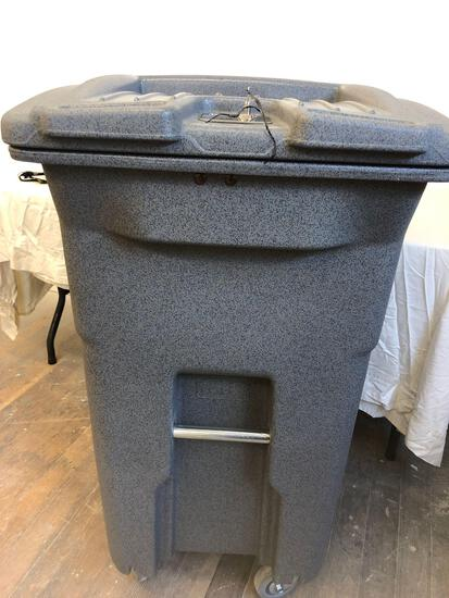 New 64 gallon Toter recycling bin with lock
