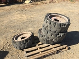 Pallet of (4) Solid Tire Rims, Fits Skid Steers.