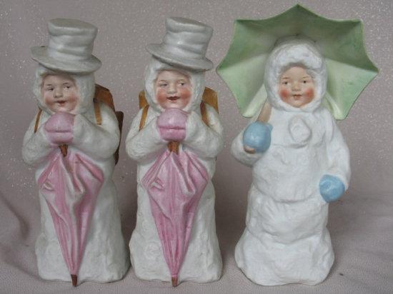 Lot 1. Three vintage German Snow Baby Flower vases 20cm, intaglio blue eyes