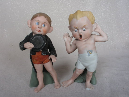 Lot 14. Two possible Schafer & Vater character boy googly bisque figurines