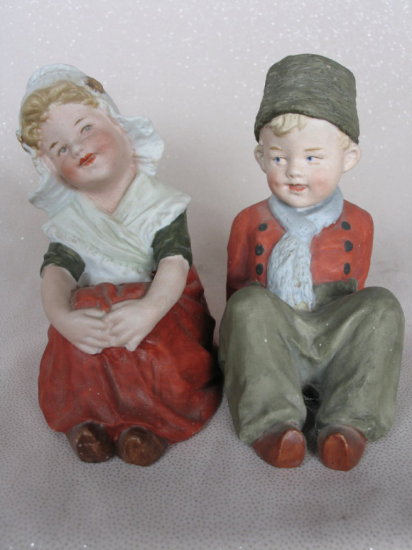 Lot 15. Two antique bisque Gebruder Heubach figurines. Seated matching Dutc