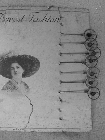 Lot 18. Rare Victorian Austria Seven Hat Pins on original card, 28cm long w