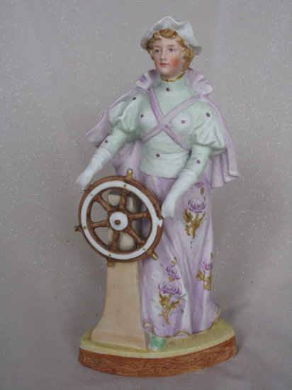 """Lot 20. Antique bisque Gebruder Heubach """"Sailor Lady at The Wheel"""" figurine"""