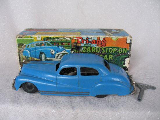 Lot 21. Boxed clockwork Triang Wizard StopOn Car. Blue No2 Minic series tin