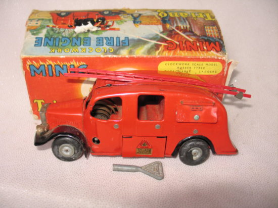 Lot 22. Boxed clockwork Triang 'Minic Fire Engine'. Post war with original