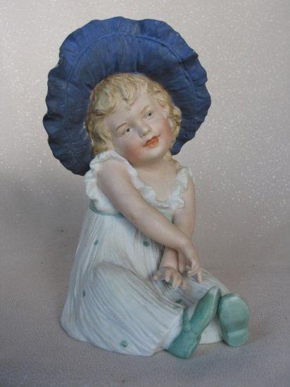 """Lot 25. Bisque 1910s Gebruder Heubach """"Flower Child"""" seated figurine 20cm c"""