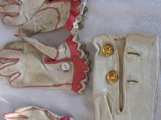 Lot 6. Rare two pair of Jumeau 1880s doll gloves, white and red kid leather