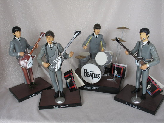 Set of Hamilton 1991 Beatles figures with hang tags instruments. George's p