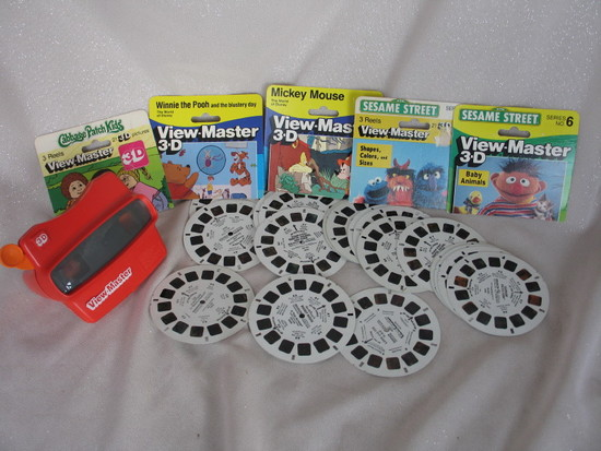 Red plastic vintage 3D View Master and 19 reels. Includes CPK, Disney, Mick