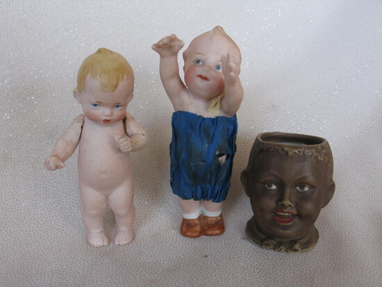 Four cabinet figurines etc:- German 10.5 cm bisque frozen child with outstr
