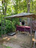 SQUARE UMBRELLA AND PERGOLA, ITEMS IN BACKGROUND NOT INCLUDED