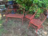 TWO RED METAL ROCKING PATIO CHAIRS AND A BENCH