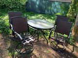 FOUR SWIVEL PATION CHAIRS AND MATCHING GLASS TOP TABLE