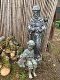 SAINT STATUE AND CHILD WITH DOG STATUE