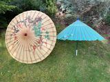TWO PAINTED PAPER PARASOLS