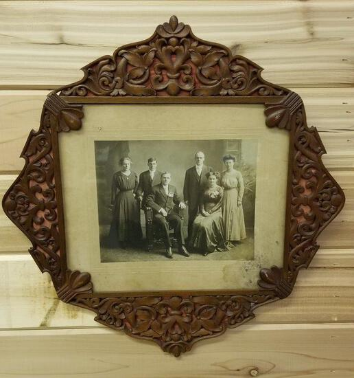 FRAMED CARVED BY A VIOLIN MAKER IN 1912, FAMILY PORTRAIT