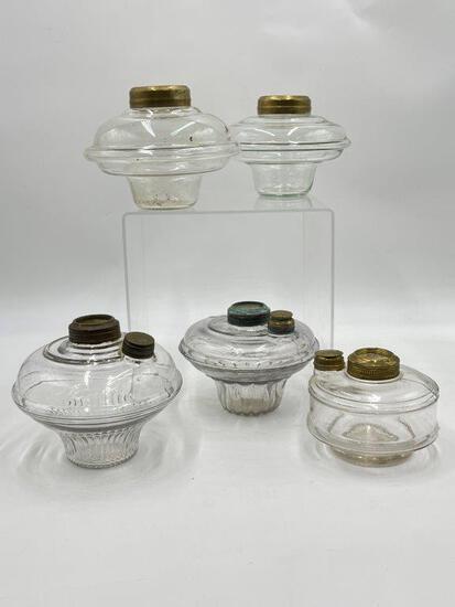 FIVE ANTIQUE  OIL LAMP INSERTS